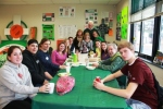 Tommy Sands (r) and his son Fionán (l) lunch with Ms. Deborah Bouchard's Irish  Literature Studies Program students with (rear left-to-right) Patricia Neiswender,  Ms. Bouchard, Jennifer Carraher and Museum Trustee Jack Mulvey at Shenendehowa.